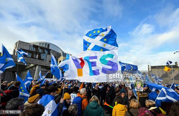 Activists attend an anti-Conservative government, pro-Scottish independence, and anti-Brexit demonstration outside Holyrood, the seat of the Scottish...