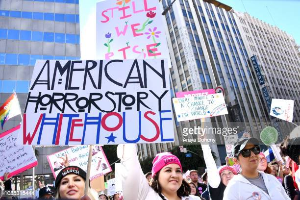 Activists attend the 2019 Women's March Los Angeles on January 19 2019 in Los Angeles California