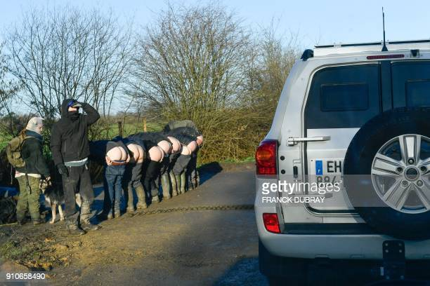 Activists bare their backsides as the PaysdelaLoire regional prefect convoy drives past on the departmental road D281 crossing the Zad of...