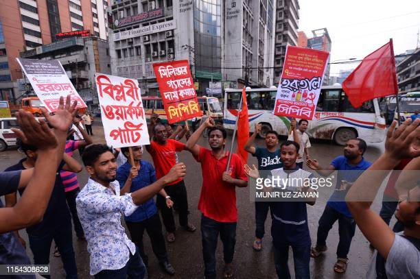 Activists block a road during a halfday strike in Dhaka on July 7 protesting the Bangladeshi governments decision to hike gas prices Bangladeshi...