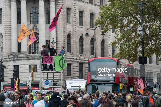 Activists block a road into Trafalgar square with a mobile scaffold on October 7 2019 in London England Extinction Rebellion occupy several sites...