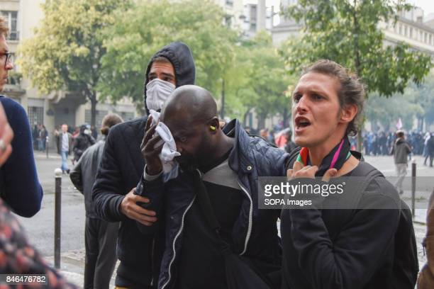 Activists bring away their injured friend during the nationwide strike called by various French unions against proposed labour law reforms by the...