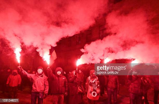 """Activists burn flares during a rally in Kiev on February 18, 2021 to commemorate the """"Heroes of the Heavenly Hundred"""", which refers to the people..."""