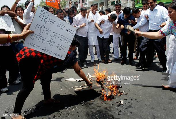 Activists burnt an effigy of Prime Minister Dr. Manmohan Singh during a protest against recent petrol hike at Sector 22 on May 24, 2012 in Noida,...