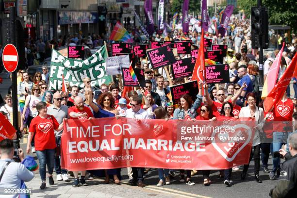 Activists campaigning for an end to Northern Ireland's ban on samesex marriage take part in a parade through Belfast city centre