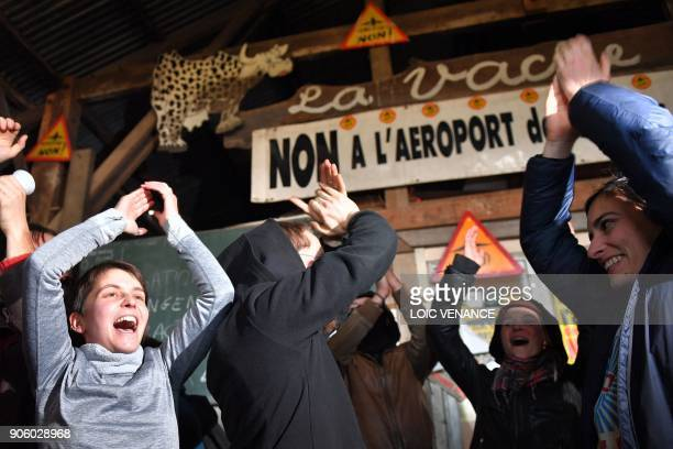 Activists celebrate at La Vache rit a farm in the 'Zad' of NotreDamedesLandes after French prime minister announced the French government's official...