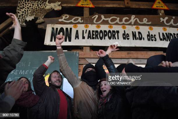 Activists celebrate at la Vache rit farm in the zad after French prime minister announced the French government's official decision to abandon the...