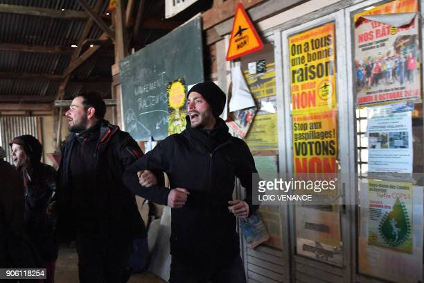 Activists celebrate at la Vache Rit farm in the 'Zad' after the French prime minister announced the French government's official decision to abandon...