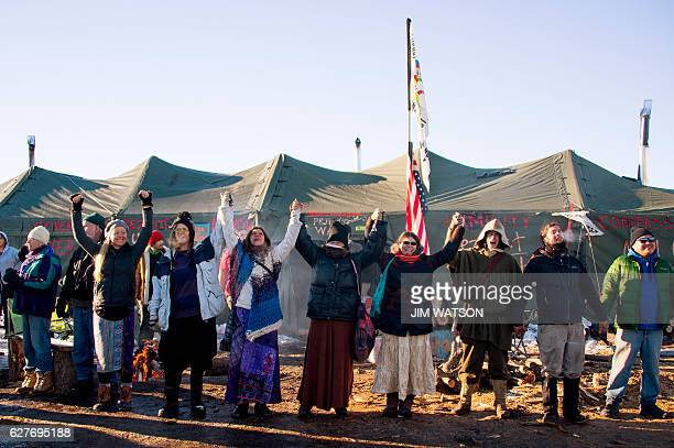 Activists celebrate at Oceti Sakowin Camp on the edge of the Standing Rock Sioux Reservation on December 4 2016 outside Cannon Ball North Dakota The...