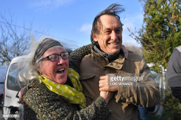 Activists celebrate in front of La Vache rit a farm in the 'Zad' of NotreDamedesLandes after French prime minister announced the French government's...