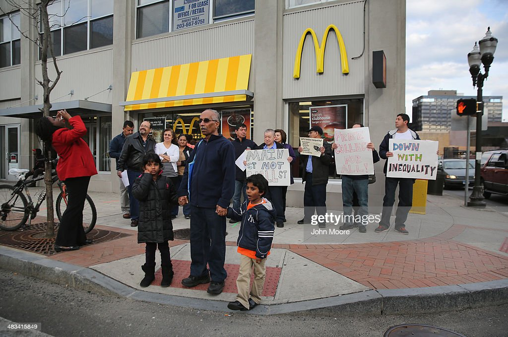 Activists chant for higher wages outside a McDonald's restaurant on April 8, 2014 in Stamford, Connecticut. Demonstrations were organized across the state by Connecticut Working Families to bring attention to minumum wages paid by fast food chains and Wal-Mart stores.