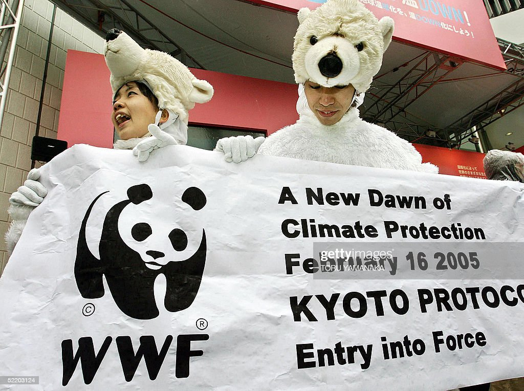 Activists clad in polar bear outfits hold a banner in the Ginza shopping district of Tokyo, 16 February 2005, to celebrate the Kyoto Protocol. The landmark treaty requiring cuts in gas emissions causing global warming took effect 16 February with support of 141 nations. AFP PHOTO/Toru YAMANAKA