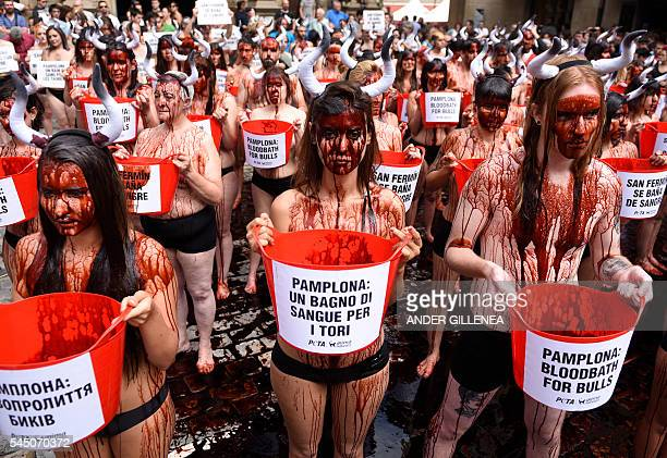TOPSHOT Activists covered in fake blood protest against bullfighting and bullrunning during a demonstration called by the People for the Ethical...