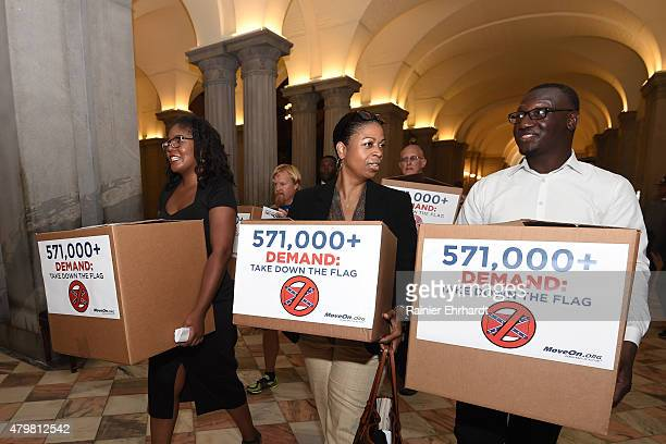 Activists deliver boxes of MoveOn petitions to take down the Confederate flag in front of the Statehouse on July 7 2015 in Columbia South Carolina