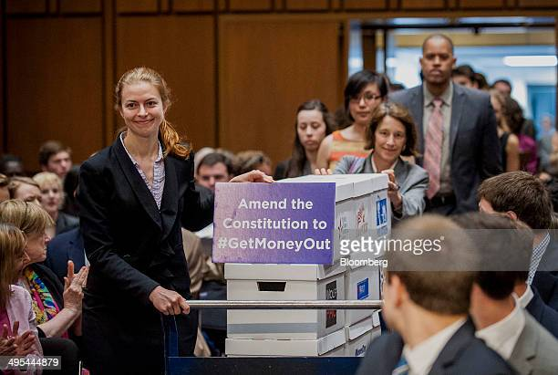 Activists deliver petitions in support of a proposed constitutional amendment on campaign finance during a Senate Judiciary Committee hearing in...