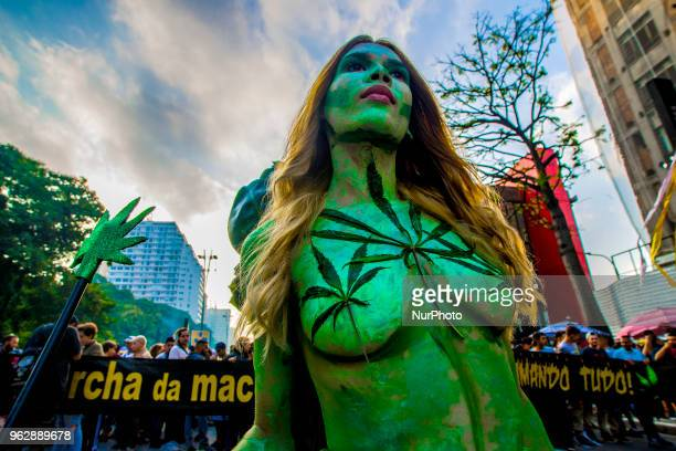 Activists demanding the legalization of marijuana march past the Reichstag during the annual Hemp Parade on May 26 2018 in São Paulo Brazil...