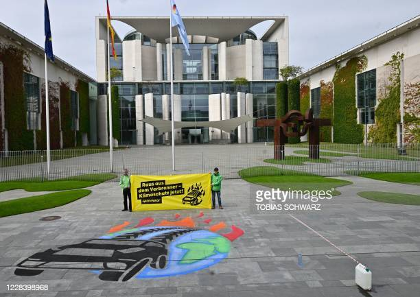 Activists demonstrate against the German government's transport policy and for a traffic turn outside the Chancellery in Berlin where German...