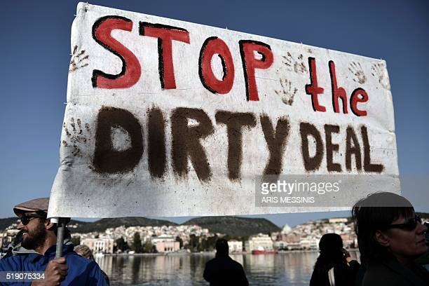 Activists demonstrate at the port of Mytilene against the deportation of migrants on April 4 2016 Migrant returns from Greece to Turkey begun under...