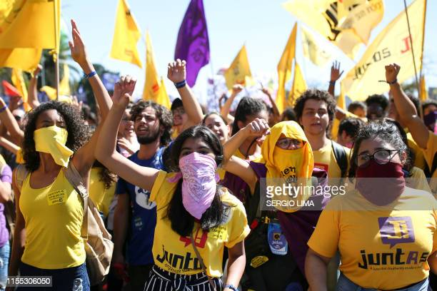 Activists demonstrate during a protest against Brazil's government reforms related with education and pension system in Brasilia Brazil on July 12...