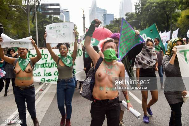 Activists demonstrate in favour of the approval of a bill to legalize abortion in Argentina in Mexico City on August 8 2018 Argentine lawmakers...