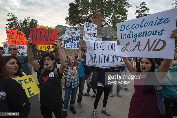 Activists demonstrate near a Hillary Clinton presidential campaign fundraiser with US President Barack Obama to call for a halt to the Dakota Access...