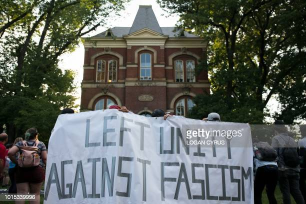 Activists demonstrate on the campus of The University of Virginia one-year after the violent white nationalist rally that left one person dead and...