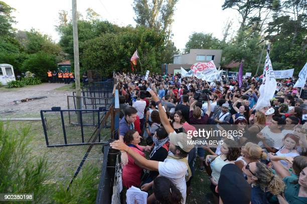 Activists demonstrate outside former Buenos Aires police chief Miguel Etchecolatz's house to protest after the justice allowed him to serve the rest...
