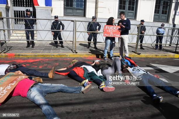 Activists demonstrate outside the Paraguayan Foreign Minister in Asuncion to protest against the inauguration of the Paraguayan embassy in Jerusalem...