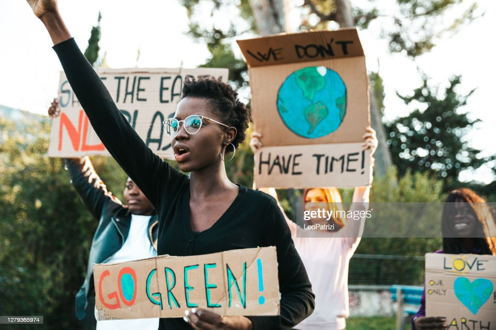 Activists demonstrating against global warming : Stock Photo