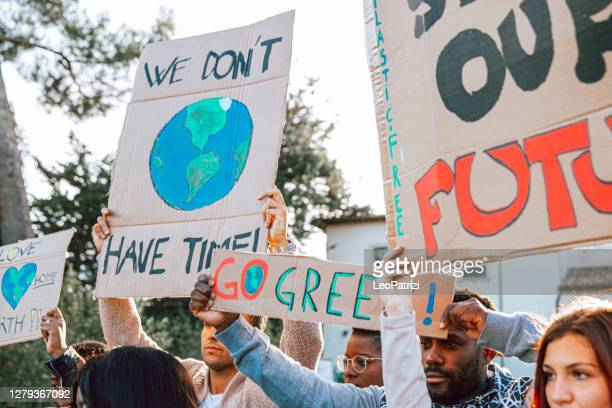 activists demonstrating against global warming - striker stock pictures, royalty-free photos & images