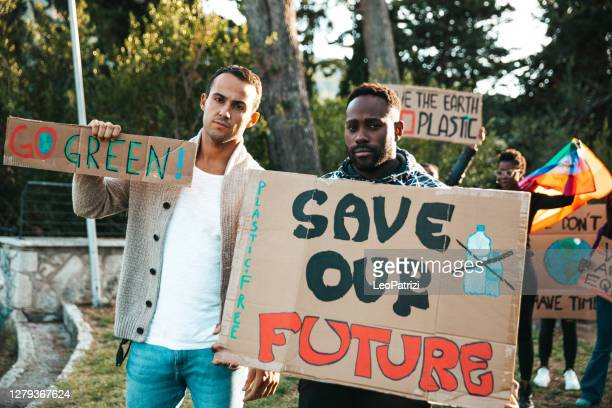 activists demonstrating against global warming - political rally stock pictures, royalty-free photos & images