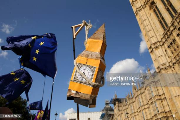 TOPSHOT Activists display a model of Big Ben and EU flags outside the Houses of Parliament in central London on September 4 2019 Britain's ruling...