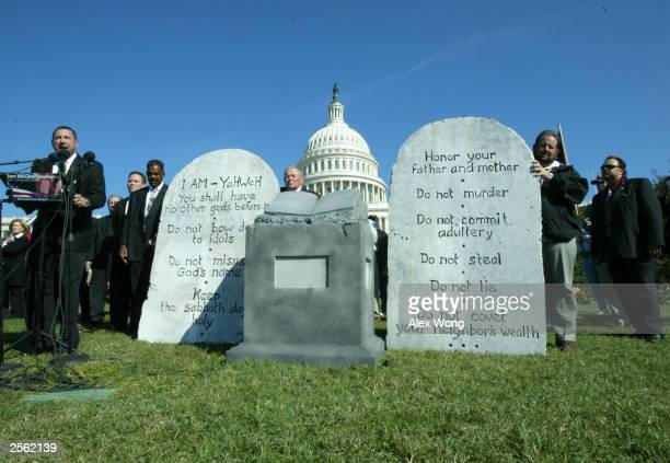Activists display a representation of the Ten Commandments October 5 2003 during a rally at the West Lawn of the US Capitol in Washington DC...
