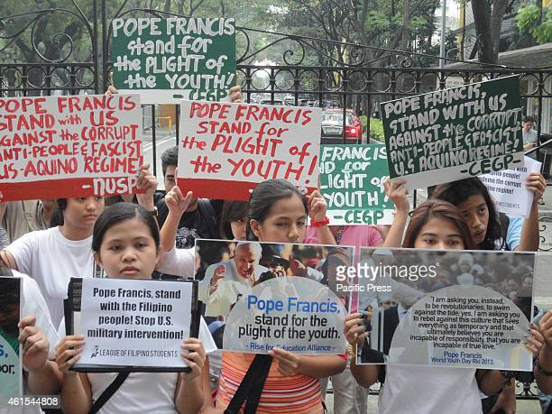 Activists display placards and postcards of Pope Francis in front of University of Santo Tomas where the Pope is expected to meet with youth...