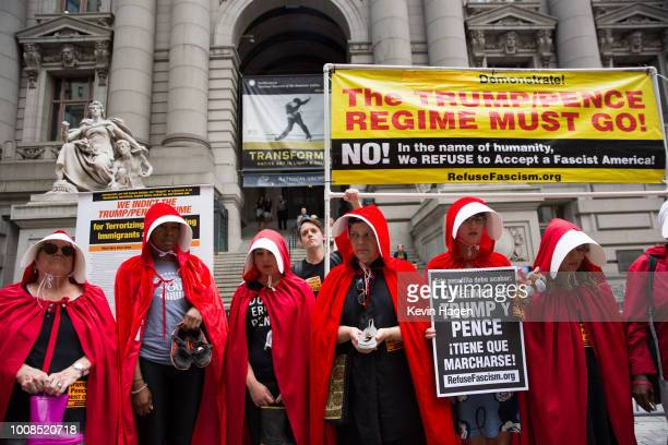 Activists dressed in the red garb of The Handmaid's Tale protest the Trump administration's immigration policies outside of the Department of...