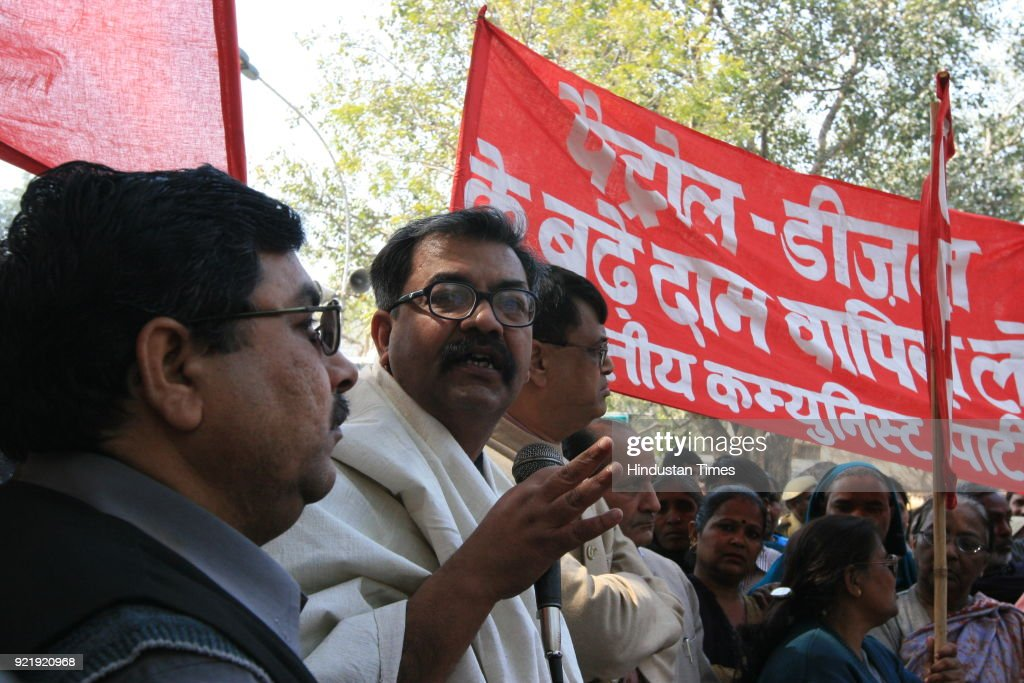 CPI (M) activists during their protest against the hike in the prices of petroleum products, at the Parliament Street in New Delhi.
