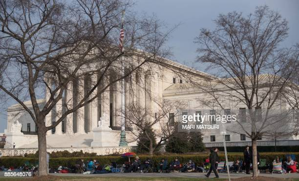 Activists for LGBT rights line up in front of the US Supreme Court in Washington DC on December 4 on the eve of the hearing for the Masterpiece...