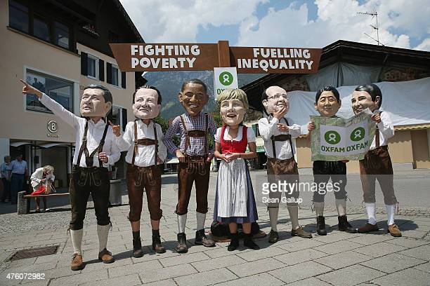 Activists for Oxfam dressed in Lederhosen and wearing masks to look like the leaders of the G7 nations pose for media in the city center the day...