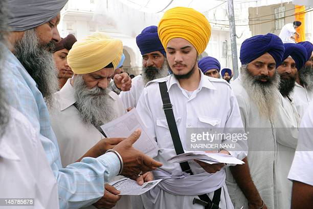 Activists from a radical Sikh organisation distribute leaflets in support of Sikh leader Sant Jarnail Singh Bhindranwale and Khalistan, the name...