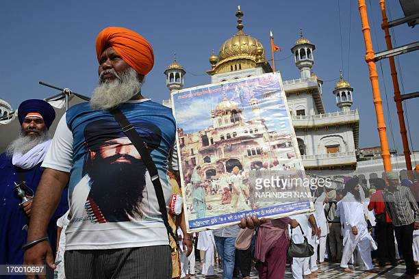 Activists from a radical Sikh organisation holds placards in support of Sikh leader Sant Jarnail Singh Bhindranwale and Khalistan, the name given for...