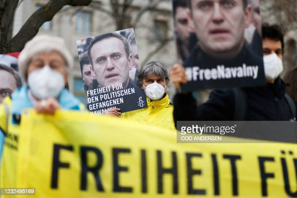 Activists from Amnesty International demonstrate outside the Russian embassy in Berlin, on April 24 calling for the release of Kremlin critic Alexei...