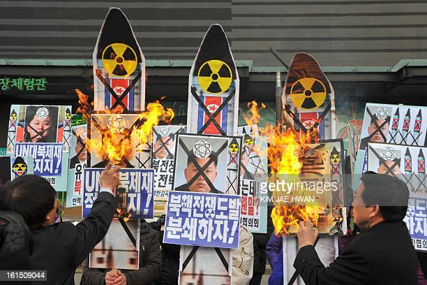 Activists from an antiNorth Korea civic group burn placards of North Korean leader Kim Jong Un during a protest against North Korea nuclear test in...