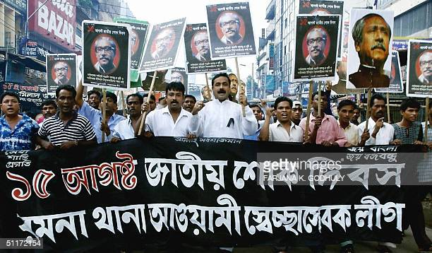 Activists from Bangladesh's main opposition Awami League shout antigovernment slogans as they march behind banners during sixhour nationwide strike...