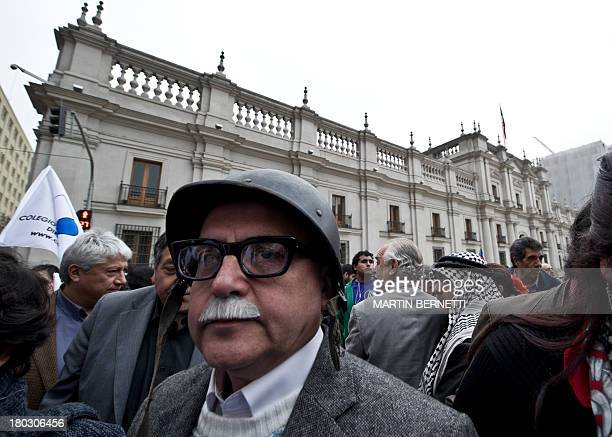 Activists from Chilean Human Rights organization Detained and Disappeared People rally outside La Moneda presidential palace in Santiago on September...