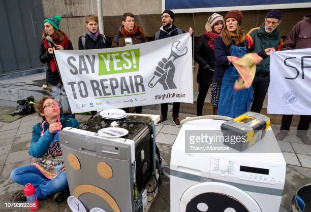 Activists from 'Cool Products' demonstrate in front of the Albert Borschette Conference Centre against the planned obsolescence of devices:...