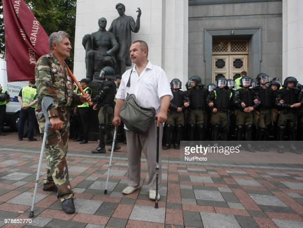 Activists from different veteran organizations and miners attend a rally demanding to keep their social benefits pensions and for full payment of...