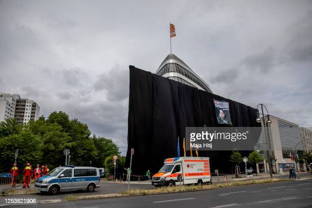Activists from Greenpeace protest against upcoming coal legislation while standing in front of the party headquarters of the German Christian...