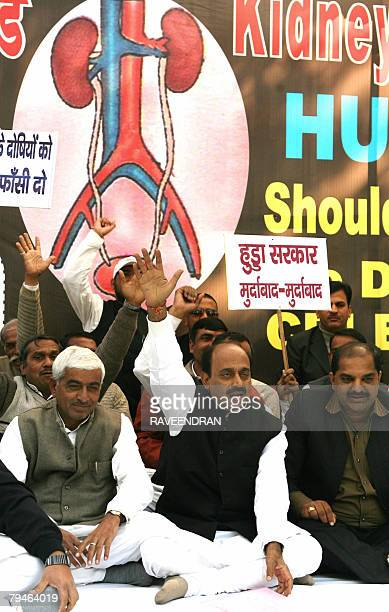 Activists from India's main opposition Bharathiya Janata Party shout antigovernment and Congressled Haryana state chief ministers slogans in New...