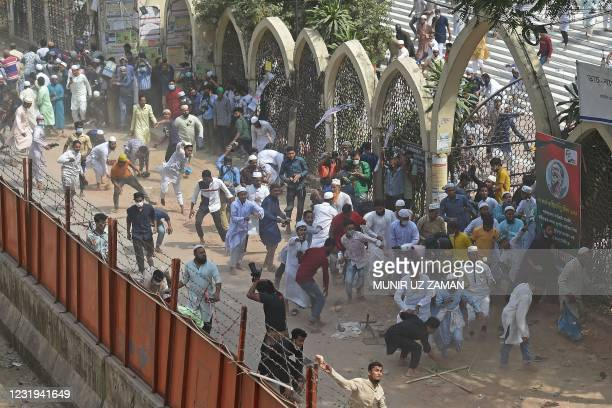 Activists from Islamist groups clash with the police as they protest against the visit of Indian Prime Minister Narendra Modi in Dhaka on March 26,...