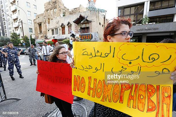Activists from of the Lebanese LGBT community take part in a protest outside the Hbeish police station in Beirut on May 15 demanding the release of...